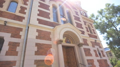 The front of a modern church, with orange brick Stock Footage