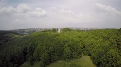 Aerial view of a church in the middle of the woods Stock Footage