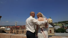 Happy gorgeous bride and stylish groom with true emotions on the roof on Stock Footage