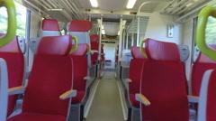 Steady cam view of european train car aisle Stock Footage