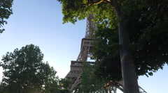 Shot of Eiffel Tower and Tourism in Paris - Through trees Stock Footage