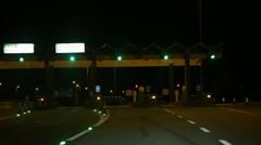 Approaching Toll Booth on Highway at Night in Europe Stock Footage