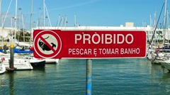 Sign, which prohibits fishing in marina suburb Stock Footage