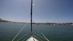 Bow of sailboat floating in California harbor Stock Footage