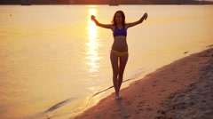 Happy woman on the beach Stock Footage