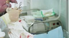 Nurse cheking reflex of newborn crying baby in maternity hospital. Listening Stock Footage