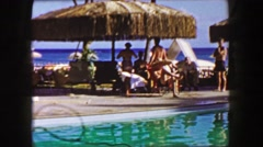 1958: Man jumps in pool with big mexican sombrero hat disappears into water. Stock Footage