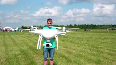 Man outdoors with remote control and drone Stock Footage