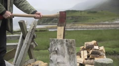 Man cutting wood with axe Stock Footage