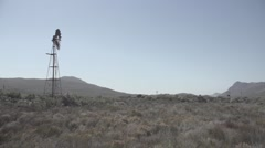 View of traditional windmill in grassland Stock Footage