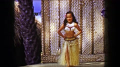 1958: Young girl hula dancer stage performing with hip shaking style. HONOLULU, Stock Footage