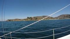 Sailing into private Laguna  Beach Cove Stock Footage