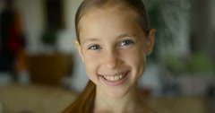 Close-up often years old girl smiling and looking att he camera Stock Footage