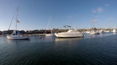 Sailing by California yacht moorings  Stock Footage