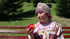 Girl in Russian folk costume and Red Apple Stock Footage