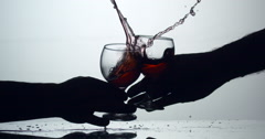 Aggressive Celebration Wine Glass Clink with spillage : Slow Motion Stock Footage
