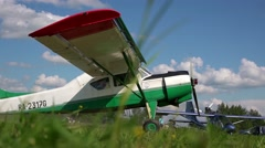 An old airplane on green grass Stock Footage