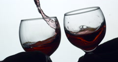 Wine Glass Clink / Toast with spillage, close up II : Slow Motion Stock Footage