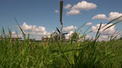 Old aircraft ready to fly with grass in foreground Stock Footage