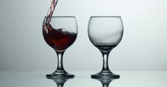 Red Wine, Summer drink Pour, two wine glasses : Slow Motion Stock Footage