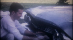 3520 family washes their 1960 Cadillac in the driveway-vintage film home movie Stock Footage