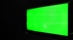 Modern TV with green screen on black background, Dolly shot Stock Footage