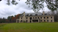 An abandoned and spooky old boarding school in the countryside. Stock Footage