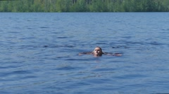 Young man bathes in the river Stock Footage