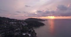 Sunset at Patong Looking Towards Tri Tra Beach in Phuket Aerial Shot Stock Footage