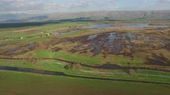 Hula Valley - Thousands of birds at Hula Nature Reserve (Israel, aerial view) Stock Footage