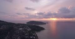 Aerial Pullback Shot of Patong and Tri Tra Beach at Sunset, Phuket Stock Footage