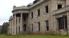 Facade of an abandoned and spooky old boarding school or mansion in the Stock Footage