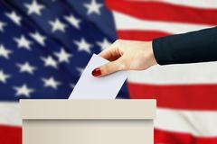 Women hand casting a vote Kuvituskuvat