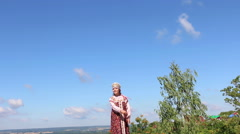 Girl in Russian folk costume welcomes Stock Footage