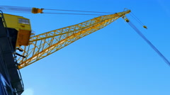 4K Yellow Crane with Cable, Blue Sky Stock Footage