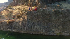 People jumping into the water. Cliff Jumping. Stock Footage