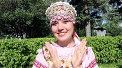 Girl in folk costume applauds Stock Footage