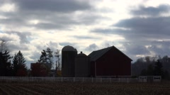 Timelapse clouds move above a Midwestern farm. Stock Footage