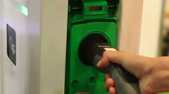 Driver plugging electric vehicle in socket, using services of charging station Stock Footage
