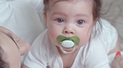 Adorable Baby with Pacifier Stock Footage