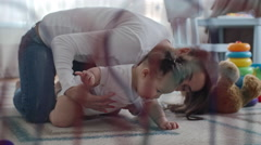 Baby Crawling with Help of Mom Stock Footage