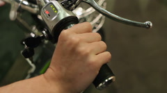 Female hand turning key to start and switch off electric bike, modern transport Stock Footage