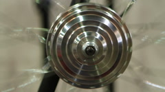 Perpetual motion of round steel construction, wheel rotating, science experiment Stock Footage