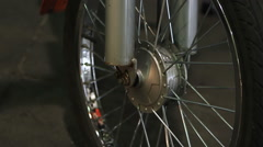 Electric bicycle details closeup, front wheel, shock absorbers on steerer tube Stock Footage