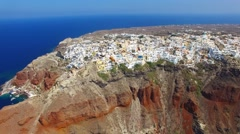 Aerial footage - White houses and blue domes of Oia, Santorini. Stock Footage
