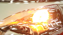 Headlamp of new auto blinking at showroom, warning light signal, car crash Stock Footage