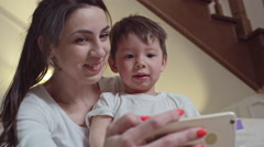 Adorable Mom and Son Taking Selfie Stock Footage
