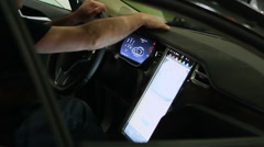 Male hands touching panel of new electric auto equipped with modern technologies Stock Footage