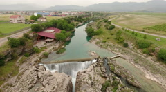 Podgorica countryside with Cijevna river flowing in valley and falling down Stock Footage