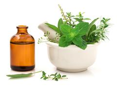 Alternative health care fresh herbal and Bottle of aromatherapy in mortar on Stock Photos